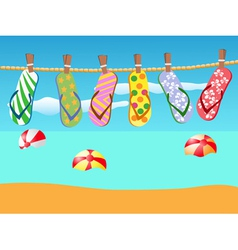 Beach sandals hanged on a rope vector