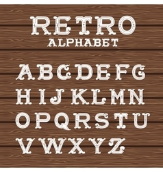 Vintage alphabet on wooden background vector