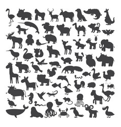 Big set of black animals silhouettes in cartoon vector