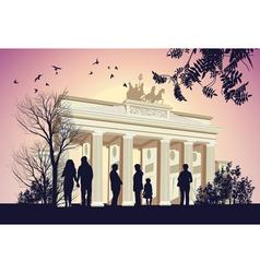 Group of people walking around the Brandenburger vector image