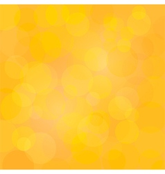 Yellow abstract circle lights bokeh background vector