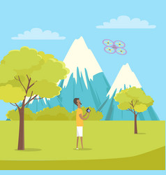 boy playing with quadrocopter near mountains vector image