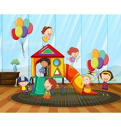 Children playing on the slide in the room vector image