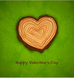 Wooden heart on green background vector