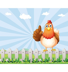 A big fat hen above the fence vector image vector image