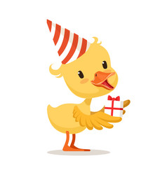 Little yellow duckling in a party hat holding gift vector