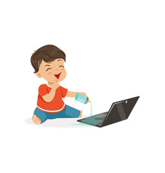 Cute little bully boy spilling water on a laptop vector