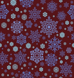 White snowflakes on an abstract red background vector