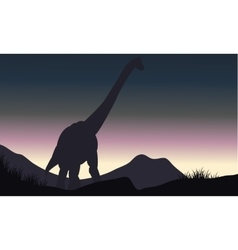 Silhouette of single brachiosaurus in hills vector