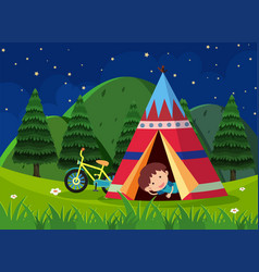 Boy camping out in the park vector