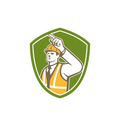 Builder construction worker pointing shield retro vector