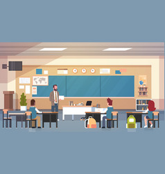 male teacher and pupils in classroom on lesson vector image vector image