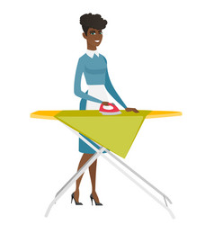 African maid ironing clothes on ironing board vector