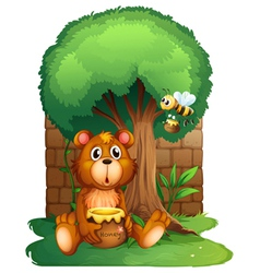 A bear and a bee under a big tree vector image