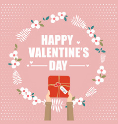 Hand holding gift box for valentines day vector