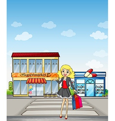A pretty girl shopping vector image vector image