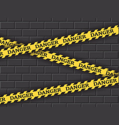 restrictive yellow tape danger against a brick vector image vector image