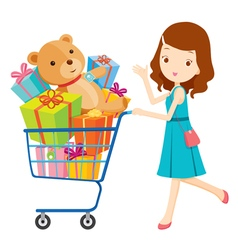 Girl pushing shopping cart full of gifts vector