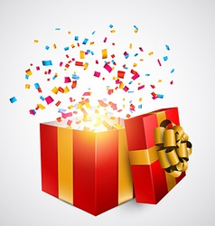 Red gift box with confetti vector