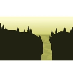 View of waterfall silhouette with green background vector