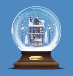 Snow globe with a house under the snow vector