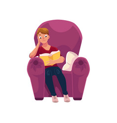 Young man reading a book in comfortable armchair vector
