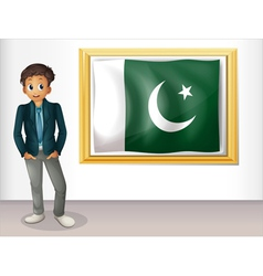 A man beside the framed flag of Pakistan vector image