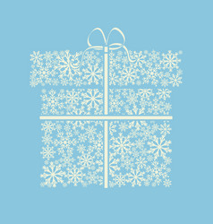 gift box made from white snowflakes on blue vector image vector image