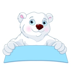 Polar bear holding a sign vector
