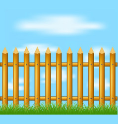 wooden fence standing in grass and blue sky vector image