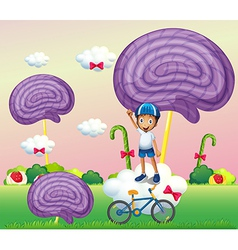 A boy above a cloud near the candyland vector