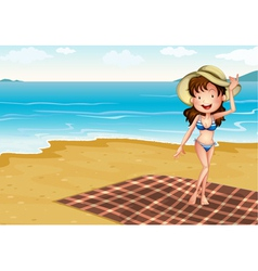 A girl in the beach with a blanket vector