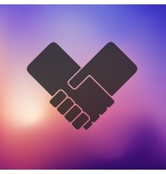 Handshake icon on blurred background vector