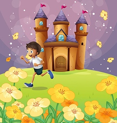 A boy playing in front of the castle vector