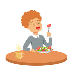 Happy redhead boy sitting at the table and eating vector
