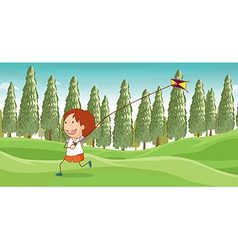 A boy playing a kite vector image