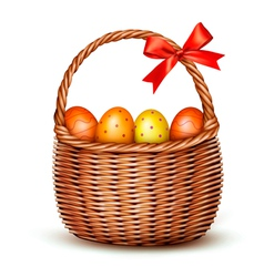 Basket with Easter eggs and a red bow vector image