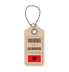 hang tag made in albania with flag icon isolated vector image vector image