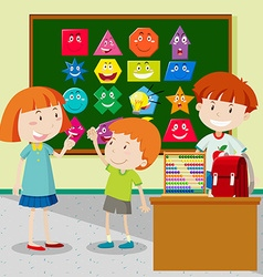 Students learning shapes in classroom vector