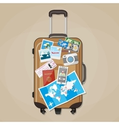 Tourist equipment on brown travel suitcase vector