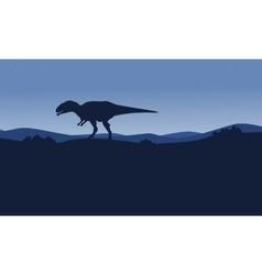 Silhouette of mapusaurus on desert scenery vector