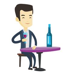 Man drinking wine at restaurant vector