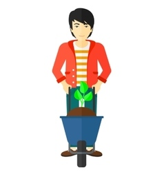 Man with plant and wheelbarrow vector image vector image