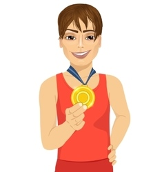 male athlete showing his gold medal vector image