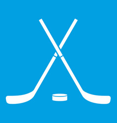 Crossed hockey sticks and puck icon white vector
