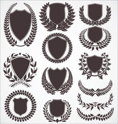 Laurel wreath and shield set vector image vector image