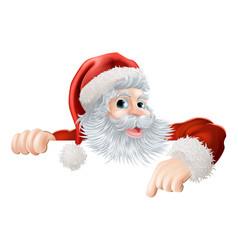christmas santa pointing down at sign vector image vector image
