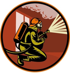 Fireman firefighter kneeling with fire hose vector