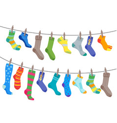 Colorful fun socks set hang on the rope vector