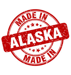Made in alaska red grunge round stamp vector